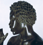 Statuette of a young musician (?), left profile. (thumbnail)